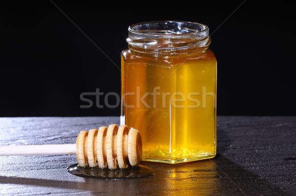 Close-up of jar of honey and wooden stick Stock photo © asturianu