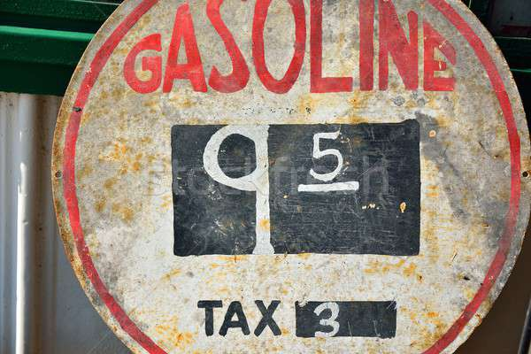 Old sign with gas prices. Stock photo © asturianu