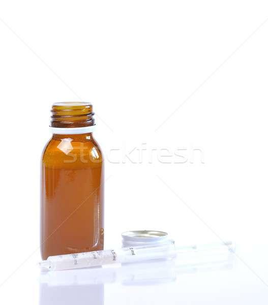 Sciroppo bottiglia siringa bianco medico medici Foto d'archivio © asturianu