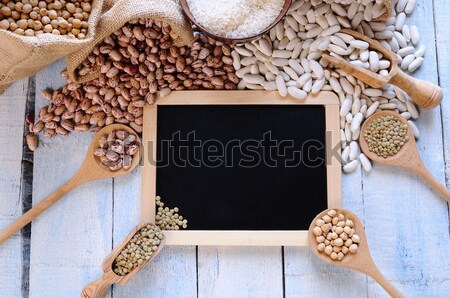 Different types of beans around black framed square on blue wood Stock photo © asturianu