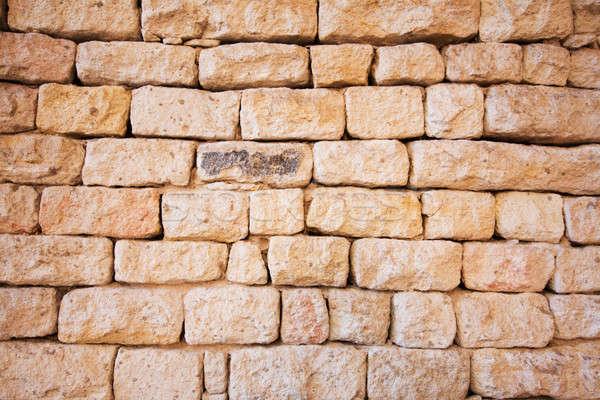 Natuurlijke steen muur oranje beton tegel Stockfoto © avdveen