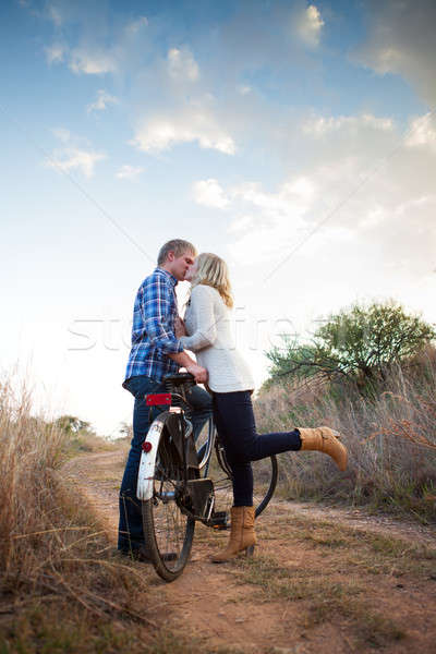 Young adult couple with old bicycle kissing Stock photo © avdveen
