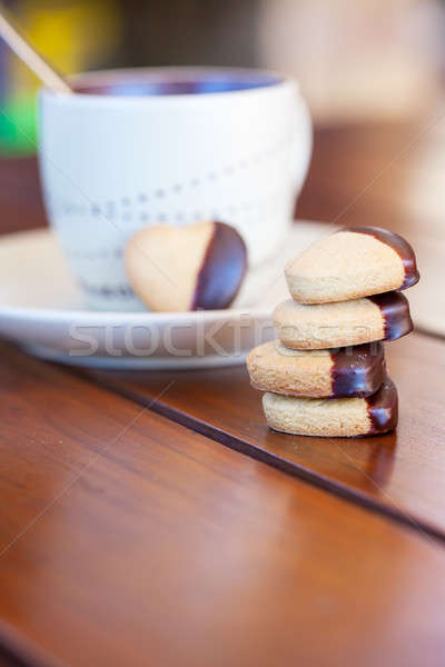 Stacked chocolate dipped heart shaped cookies and cup of coffee Stock photo © avdveen