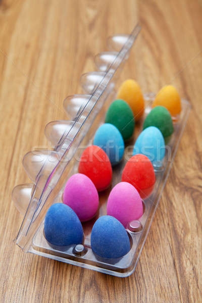 Twelve colorful chocolate easter eggs Stock photo © avdveen