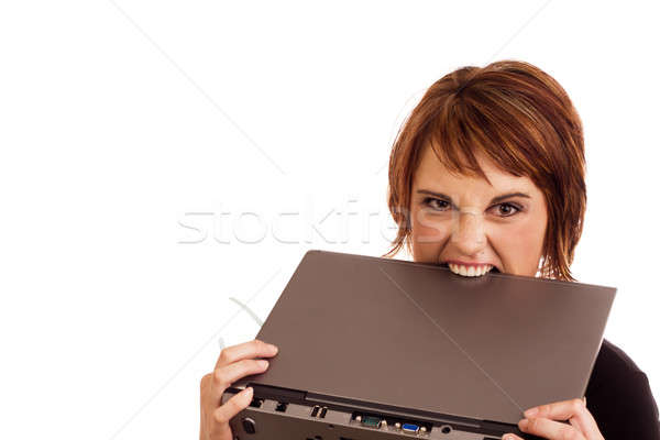 Frustrated Caucasian businesswoman biting laptop Stock photo © avdveen