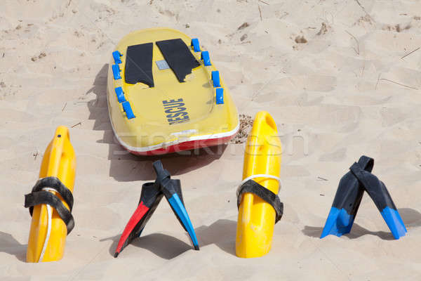 Lifesaving equipment lying on the beach sand Stock photo © avdveen