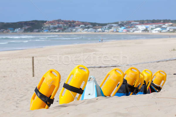 Beach with lifesaving flotation devices Stock photo © avdveen