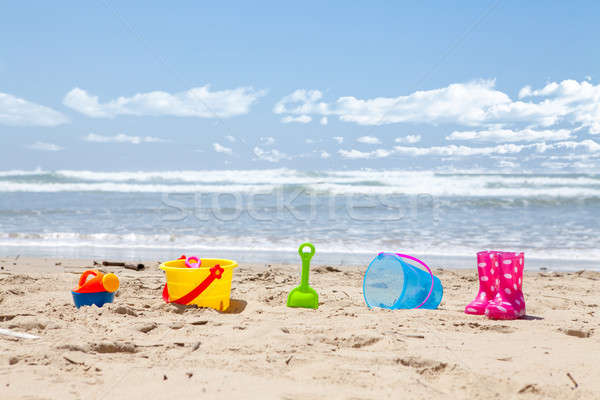 Brightly colored plastic beach toys on the beach Stock photo © avdveen