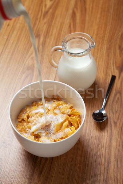 Bowl of breakfast cereal on wooden surface Stock photo © avdveen