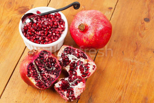 Pomegranate fruit and pips in a white bowl Stock photo © avdveen