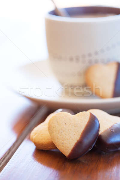 Heart shaped cookies and a fresh cappuccino Stock photo © avdveen
