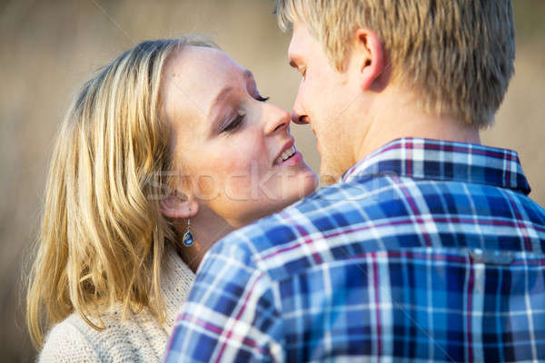 Young couple in love almost kissing Stock photo © avdveen