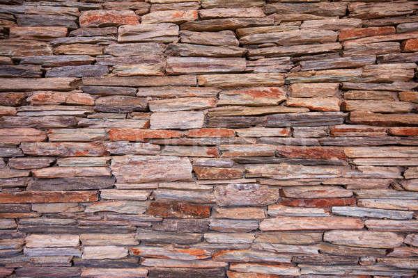 Naturalismo stonewall pedra edifício parede laranja Foto stock © avdveen