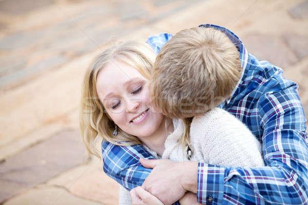 Genç beyaz erkek öpüşme boyun kadın Stok fotoğraf © avdveen