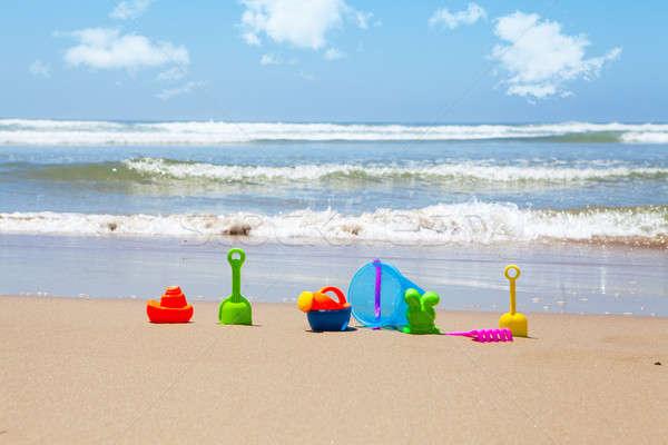 Plastic strand speelgoed zee wolken hemel Stockfoto © avdveen