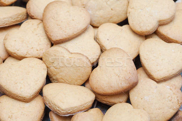 Lots of freshly baked heart shaped biscuits Stock photo © avdveen