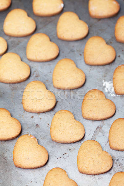 Home made heart shaped cookies on baking tray Stock photo © avdveen