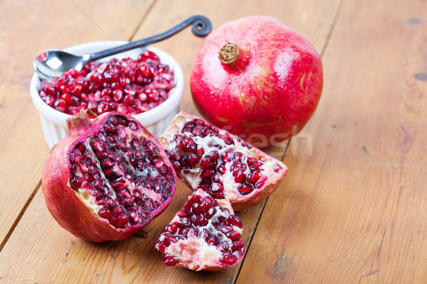 Pomegranate fruit and pips in bowl Stock photo © avdveen
