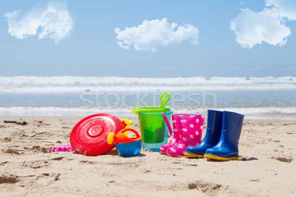 Kleurrijk plastic speelgoed strand zee wolken Stockfoto © avdveen