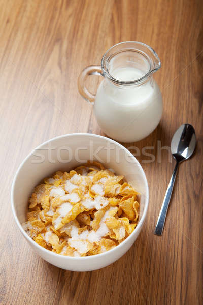 Breakfast cereal with milk and spoon Stock photo © avdveen