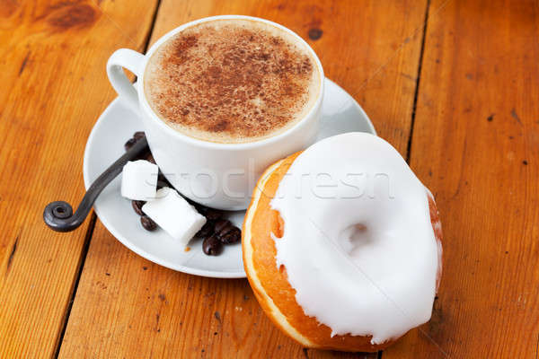 Fresh cappuccino and doughnut with white frosting Stock photo © avdveen