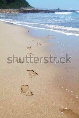 Insan ayak izleri plaj kumu deniz yaz Stok fotoğraf © avdveen