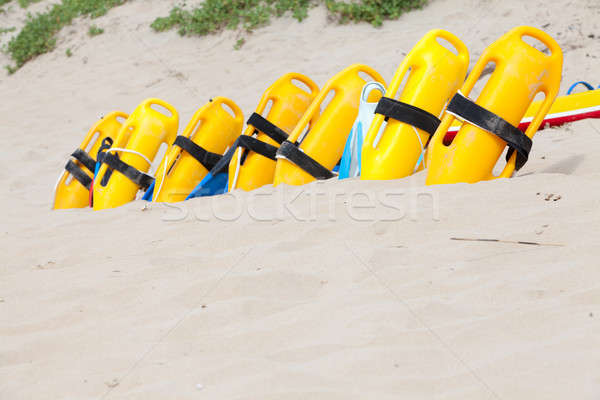 Bright yellow life saving equipment on the beach sand Stock photo © avdveen