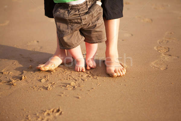 Mother and baby playing on the beach Stock photo © avdveen