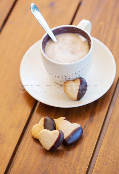 Chocolate dipped heart shaped cookies and coffee Stock photo © avdveen
