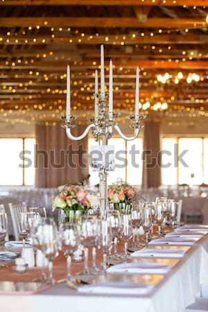 Decorated tables with candelabra at wedding reception, selective Stock photo © avdveen