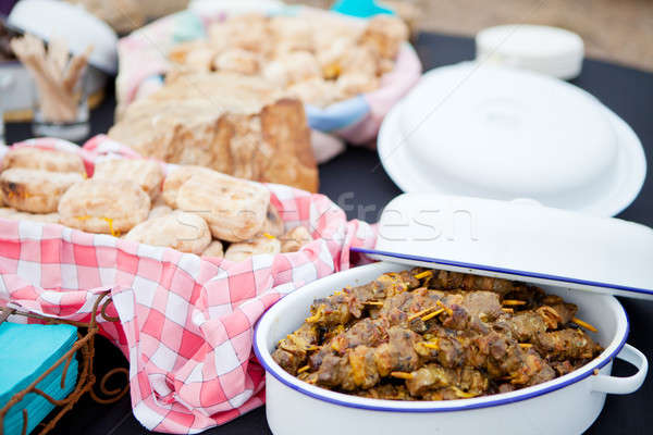 Fresh roasted bread and mutton kebabs in dishes Stock photo © avdveen