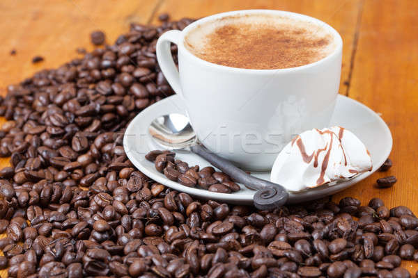 Freshly brewed cup of coffee served with meringue Stock photo © avdveen