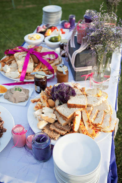 Assortment of bread and condiments on table at a wedding Stock photo © avdveen