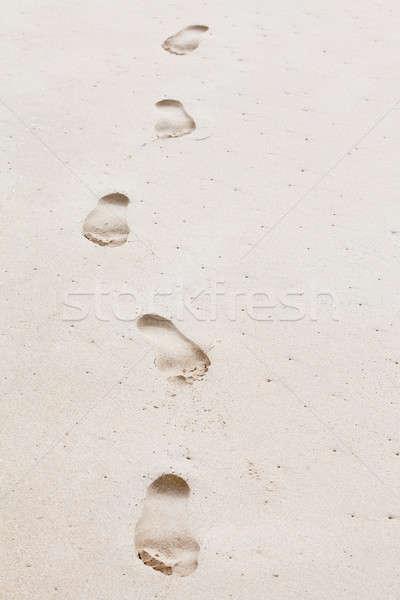 Menselijke voetafdrukken leidend exemplaar ruimte vijf Stockfoto © avdveen
