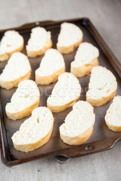 Tranches pain français pain plateau fraîches Photo stock © avdveen