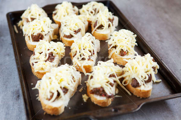 Fresh french rolls loaded with cheese and chicken livers Stock photo © avdveen