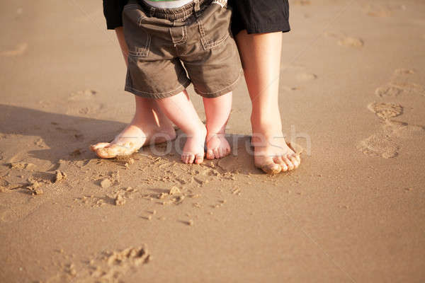 Mother and baby walking on beach Stock photo © avdveen