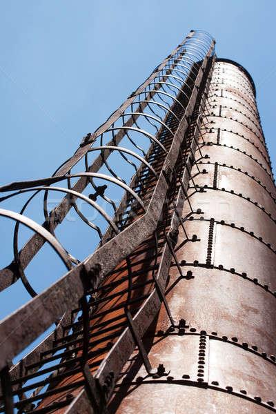 Industriële fabriek schoorsteen blauwe hemel ladder bouw Stockfoto © avdveen