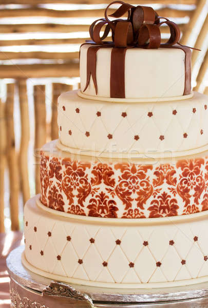 Layered white wedding cake with chocolate detail Stock photo © avdveen