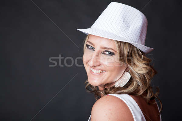 Smiling Caucasian woman wearing a pinstrip white hat Stock photo © avdveen