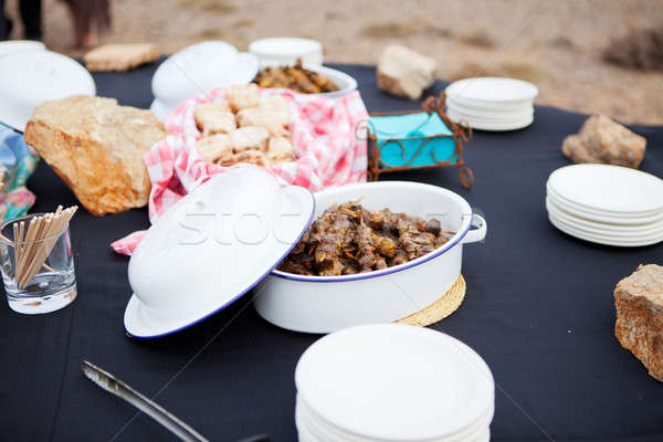 Fresh mutton meat kebabs and roasted bread served in dishes Stock photo © avdveen
