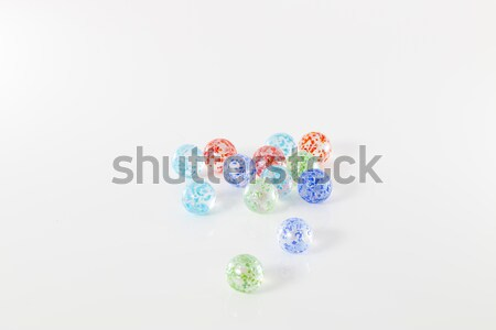 coloured marbles isolated on white background Stock photo © AvHeertum
