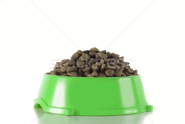 Dog food in green bowl, white studio background Stock photo © AvHeertum
