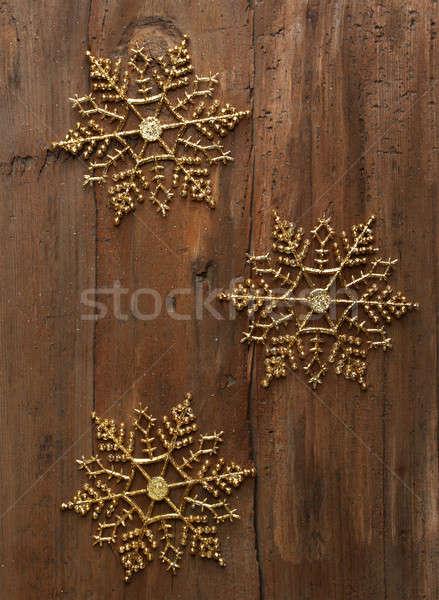 Dekoratif kar taneleri üç altın ahşap duvar Stok fotoğraf © Avlntn