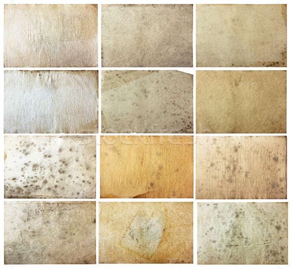 Oude papieren ingesteld geïsoleerd witte Stockfoto © Avlntn