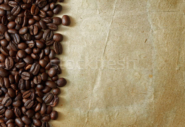 coffee beans on old paper Stock photo © Avlntn