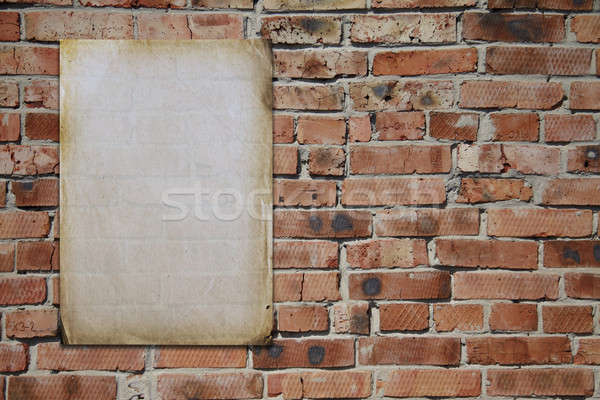 paper on brickwall Stock photo © Avlntn
