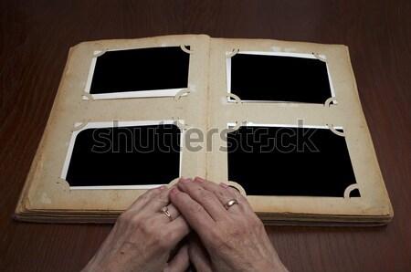 Klasszikus fényképalbum kezek öreg könyv fa Stock fotó © Avlntn