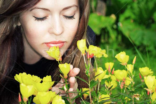 woman smelling flowers Stock photo © Avlntn
