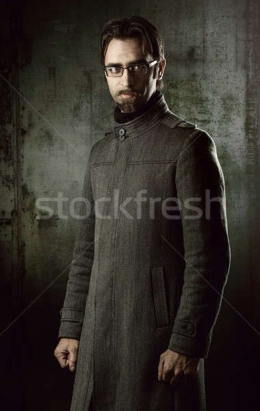 handsome man in black coat Stock photo © Avlntn